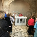 Fr. Otis celebrating Mass with pilgrims at the Catacombs